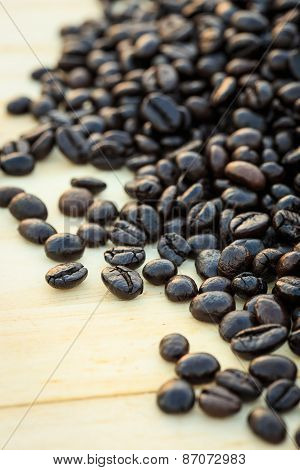Close Up Roasted Coffee Beans On Wooden Background