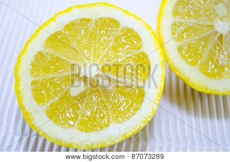 Halved Lemon On A White Cardboard Close Up