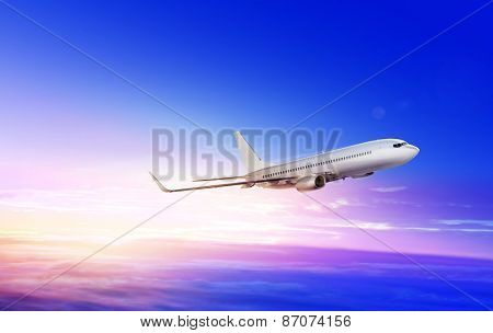 flying-up white passenger airplane in the sky at sunrise