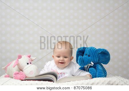 Happy Baby Reading A Book