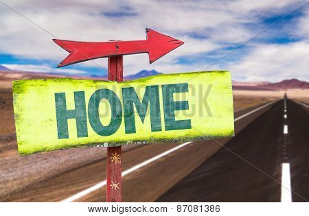 Home sign with road background