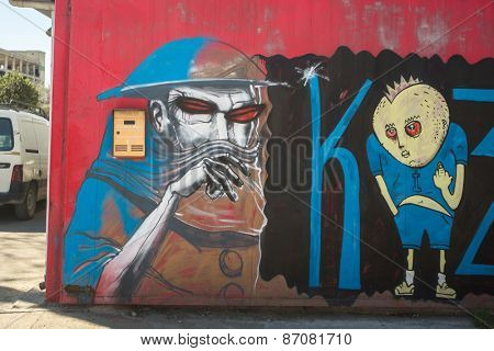 ATHENS, GREECE - APR 3, 2015: Contemporary graffiti art on city walls. Hardships of Greek economic crisis since 2010 have led to a new wave of graffiti - making Athens a new Mecca for street artists.