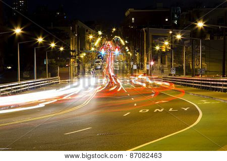 Driving thru busy intersection at night