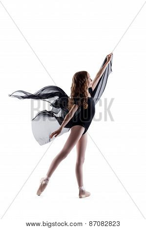 Smiling curly ballerina dancing with cloth