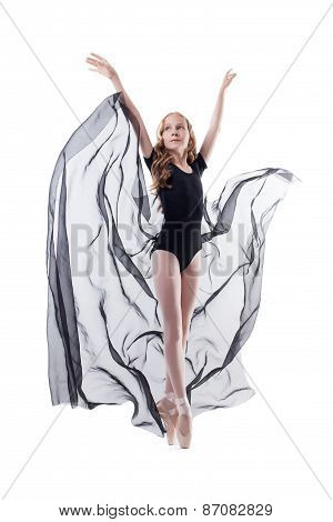 Elegant young ballerina dancing with cloth