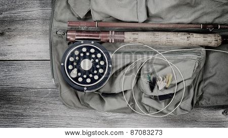 Old Trout Fishing Gear On Top Of Fishing Vest