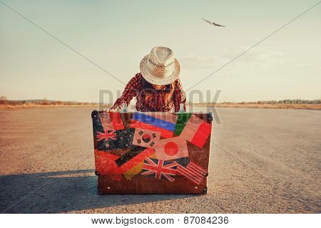 Traveler Looking For Something In The Suitcase