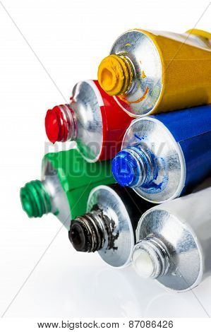 Six Tubes With Colorful Paints On A White Background