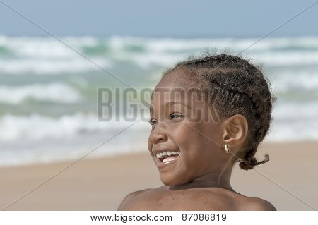 Happy girl at the beach, six years old