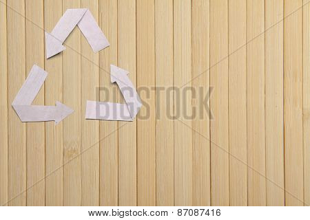 natural bamboo texture, wooden backgroud and paper recycle symbol