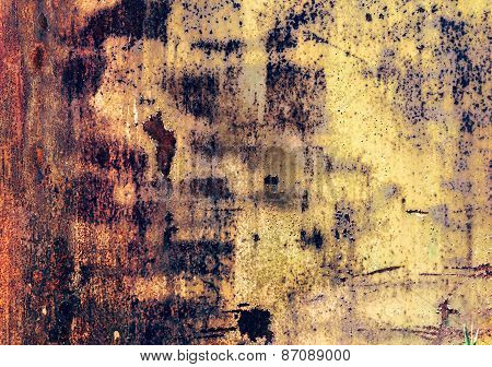 Industrial rusty metal background texture with flaking and peeling paint