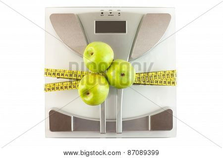 Scale With A Measuring Tape And Apple