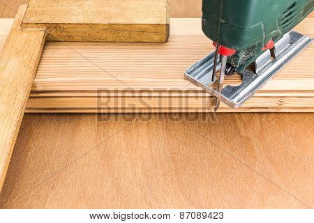 Electric Jigsaw On Wooden Planks