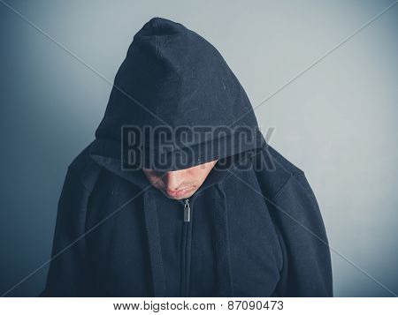 Young Man Wearing A Hooded Top