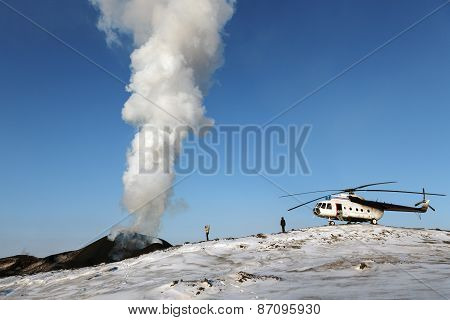 Tourists And Helicopter Near The Erupting Tolbachik Volcano. Kamchatka Peninsula