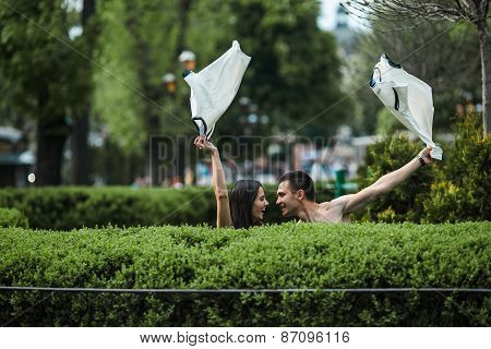 Couple Undress In The City