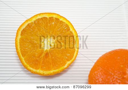 Halved Orange On A White Cardboard