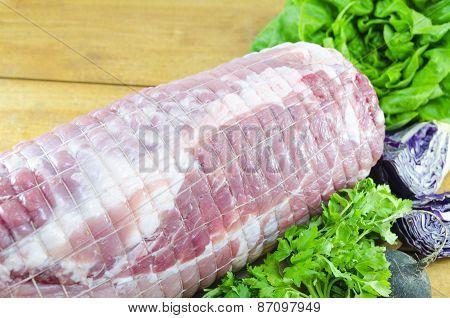 Raw Meatloaf On A Cutting Board