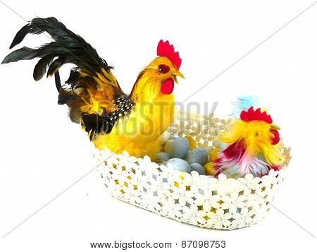 An isolated basket with Easter chickens and eggs