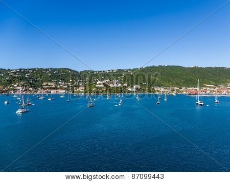 Sailboats Across Massive Blue Bay