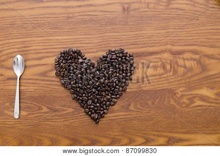 spoon and coffee beans like a heart