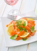 foto of redfish  - salad on salmon on the white plate - JPG