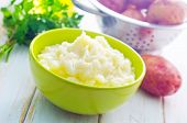 picture of mashed potatoes  - mashed potato in bowl and on a table - JPG