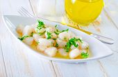 image of scallops  - scallop with oil on the plate and on a table - JPG