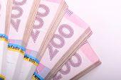 Постер, плакат: Pile Of Ukrainian Money