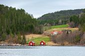 picture of barn house  - Traditional Norwegian small village colorful wooden houses and barns on the North Sea coast - JPG