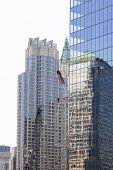 image of skyscrapers  - Reflections of skyscrapers in the facade of another skyscraper in Manhattan - JPG