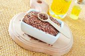 foto of flax seed oil  - flax seed in bowl and on a table - JPG