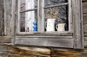 picture of timber  - Window in a old timbered house with some sommer flowers left on inside photo taken in the North of Sweden - JPG