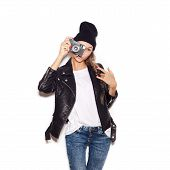stock photo of beanie hat  - Hipster girl in hat with vintage noname camera - JPG