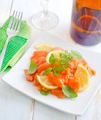 picture of redfish  - salad with salmon on the white plate - JPG
