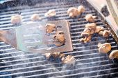 picture of champignons  - Champignon white mushrooms on spatula grilled on BBQ with steam and drops of water - JPG