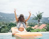 picture of hot-weather  - Young pretty fashion sport woman having fun outdoor in summer on tropic island in hot weather on pool party - JPG