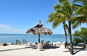 picture of gazebo  - Gazebo on the beach with ocean and blue sky in Florida tropical setting - JPG