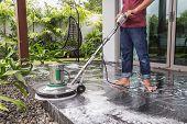 pic of granite  - Thai people cleaning black granite floor with machine and chemical - JPG