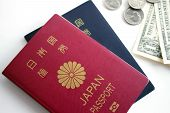 picture of japanese coin  - Japanese passport and dollar bill quarterdime nickel - JPG