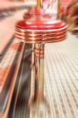 stock photo of diners  - Red vinyl stools in a vintage diner - JPG