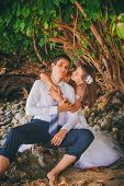 ������, ������: Bride Embrace Her Groom Sitting On The Rock