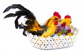 picture of pastel colors  - Colorful chickens in a basket with eggs in pastel colors as a Easter decoration over white - JPG