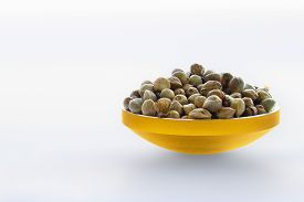 picture of seed bearing  - Hemp seeds in a gilded bowl in a white background - JPG