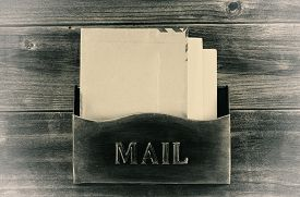 pic of mailbox  - Vintage concept of an old metal mailbox with letters inside on rustic wood - JPG
