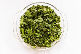 pic of ipomoea  - Chopped water spinach also called Ipomoea aquatica kept in a glass bowl on a plain background - JPG