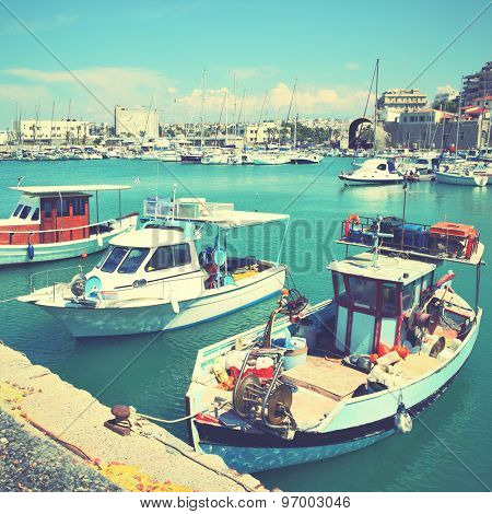 Old fishing boats and yachts in Heraklion port, Greece. Instagram style filtered image