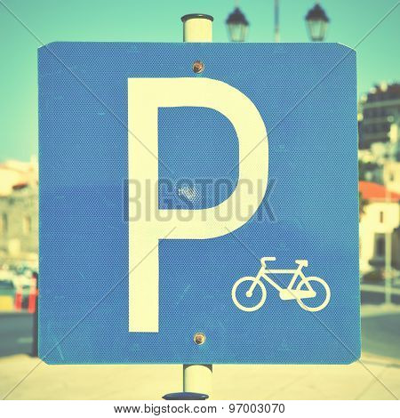 Bicycle parking lot sign close-up. Instagram style filtered image