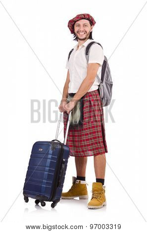 Man in scottish skirt with suitcase isolated on white