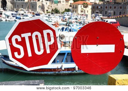 Stop traffic and No Entry signs on the barrier